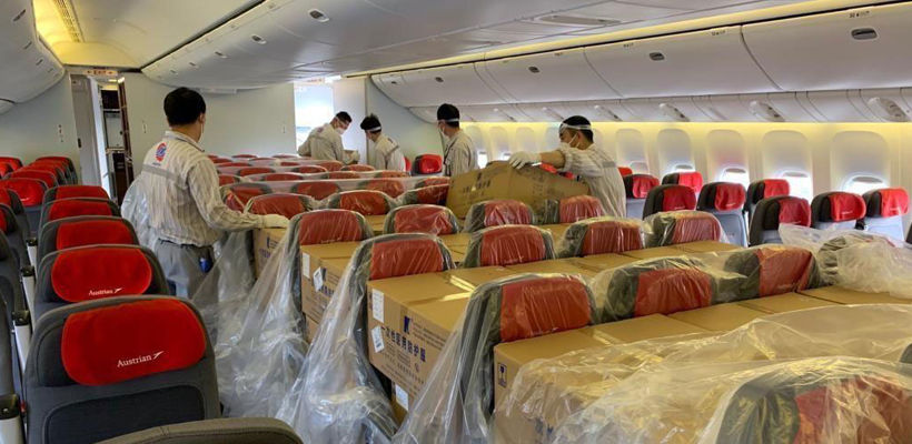 Austrian Airlines' B777 with cargo placed on seats in passenger cabin